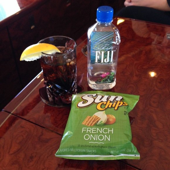 Drink service of diet coke and chips