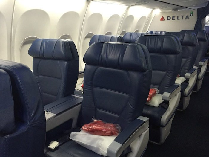 Typical domestic first class cabin. Nicer than the back, and free Bloody Marys, but... worth your miles?